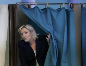 French far-right National Front leader Marine Le Pen leaves the polling booth as she votes in Henin-Beaumont, northern France, March 29, 2015. France goes to the polls in a two-round departmental election for local officials on March 22 and March 29.     REUTERS/Pascal Rossignol