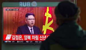 "A man watches a television news broadcast at a railway station in Seoul on January 1, 2017 showing North Korean leader Kim Jong-Un's New Year's speech. North Korea is in the ""final stages"" of developing an intercontinental ballistic missile, leader Kim Jong-Un said on January 1, claiming the country had significantly bolstered its nuclear deterrent. / AFP PHOTO / JUNG Yeon-Je"